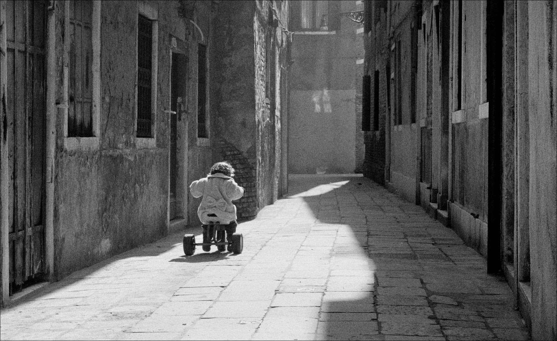 Child on Tricycle, Venice ©Paul Hampton Photographer Glasgow